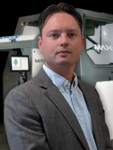 """AMSTERDAM – July 16, 2019 – – Bulk Handling Systems (BHS) has named Remi Le Grand to the position of Regional Sales Director for Max-AI®. In his new role, Le Grand is responsible for the Max-AI® sales team and business development in Europe. Max-AI technology is an Artificial Intelligence (AI) that identifies recyclables similar to the way a person does and directs sorting equipment, including robotic and optical sorters. Max-AI launched in 2017 to increase product quality, automation and intelligence in recycling facilities, and quickly gained acceptance throughout Europe and around the world. Prior to joining Max-AI in 2018 as Regional Sales Manager, Le Grand spent six years in sales with BHS-subsidiary Nihot Recycling Technology based in Amsterdam, Netherlands. """"Max-AI technology has had a great deal of success in Europe, particularly with customers that want to lower operating costs in existing facilities,"""" said Le Grand. """"It's been a pleasure to work with these breakthrough solutions that have already made such impactful results to our customers' businesses, but have yet to scratch the surface of what's possible. Max-AI technology will continue to influence our industry in meaningful and positive ways. I look forward to building our Max-AI team and delivering intelligent, effective and profitable solutions to our customers throughout Europe."""" """"Remi has a proven track record of delivering successful solutions that encompass a broad range of recycling equipment,"""" said BHS VP of Sales and Marketing Rich Reardon. """"His holistic experience in recycling systems and deep understanding of our AI and robotics offerings make him the perfect fit to take Max-AI to the next level in this region. Our Max-AI product line continues to expand in exciting ways that control more equipment and enhance total system intelligence, and we think our customers in Europe are going to benefit immensely. We are ramping up and are fortunate to have Remi leading the charge,"""" Reardon concluded"""